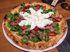 Japanese fusion pizza wins diners' hearts