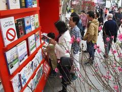 People enjoy the Book Street during Tết