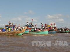 Fishermen cherish the whale at Mekong festival