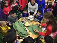 Kindergarten children learn about Tết