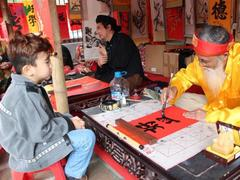 Tết event celebrates folk art, calligraphy