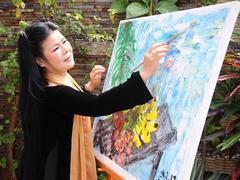 Áo dài inspired by Văn Dương Thành's art to be displayed
