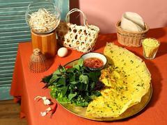 Ngon Garden launches bánh xèo Hòa Bình (peace sizzling crepe)