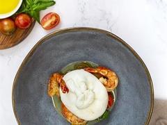 Burrata with prawns and warm marinated tomato salad