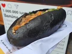 Enjoy the unique black bánh mìof Quảng Ninh