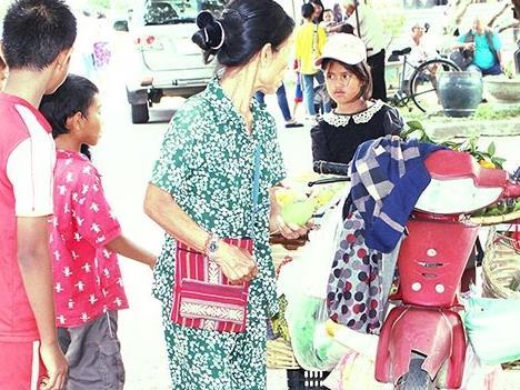 Motorbike vendors help remote ethnic communities