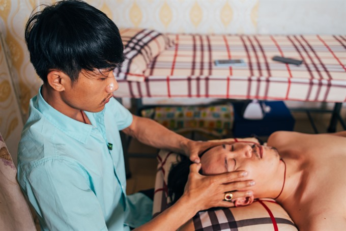 Leading: Nguyen Ngoc Hieu (left) is now the manager of two blind massage  centres in HCM CIty. VNS Photo Nguyen Dat